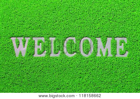 Welcome white mat isolated on green background
