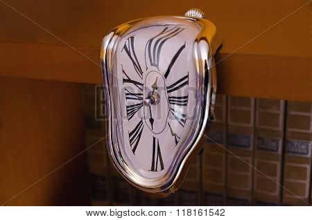 Liquefied clock flowing down table. Roman numerals. surrealism