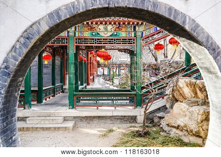 Corridor behind a moon gate in a historic traditional garden during Chinese New Year