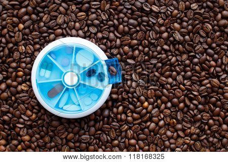 coffee beans in a pillbox