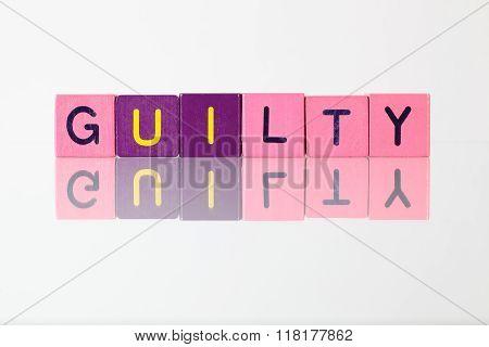 Guilty - An Inscription From Children's Blocks