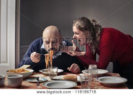 Greedy husband eating pasta