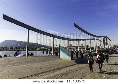 People Walking On Rambla De Mar Bridge