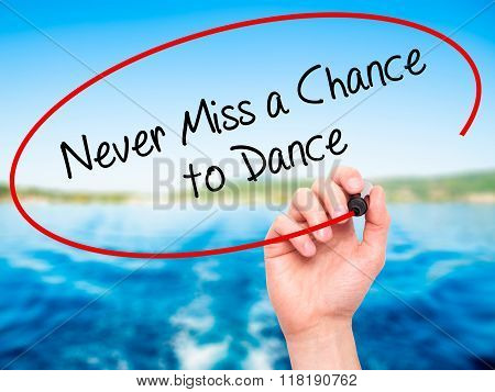 Man Hand Writing Never Miss A Chance To Dance With Black Marker On Visual Screen