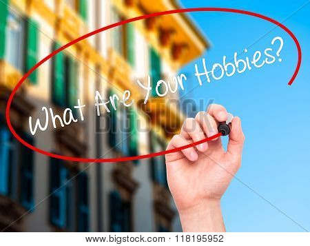 Man Hand Writing What Are Your Hobbies? With Black Marker On Visual Screen