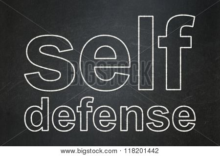 Privacy concept: Self Defense on chalkboard background