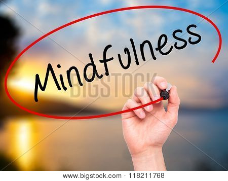Man Hand Writing Mindfulness  With Black Marker On Visual Screen