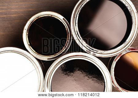 Several opend cans with paint inside
