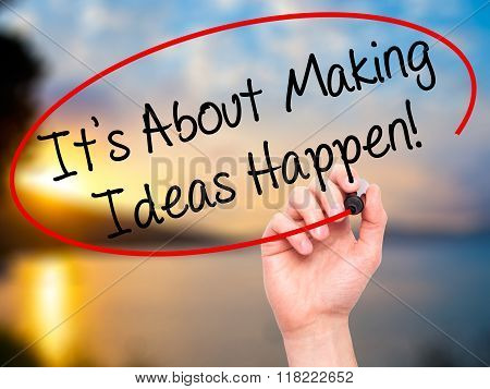 Man Hand Writing Its About Making Ideas Happen  With Black Marker On Visual Screen