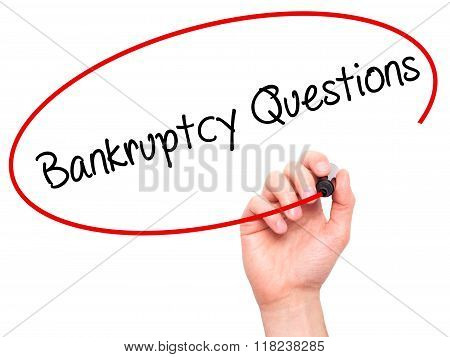 Man Hand Writing Bankruptcy Questions With Black Marker On Visual Screen