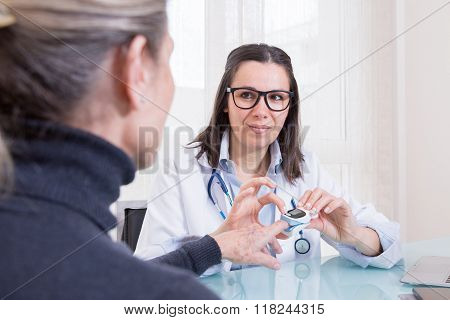 Doctor Measuring Patients Hemoglobin Level