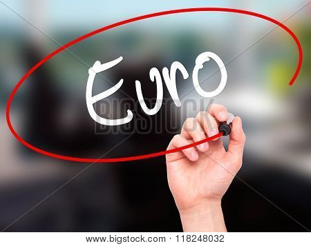 Man Hand Writing Euro With Black Marker On Visual Screen