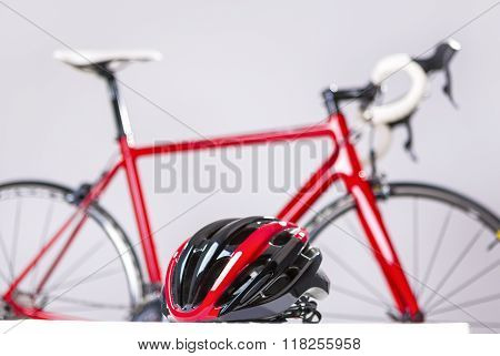 Cycling Safety Concept. Road Bike Protection Helmet In Front Of Professional Road Bike.