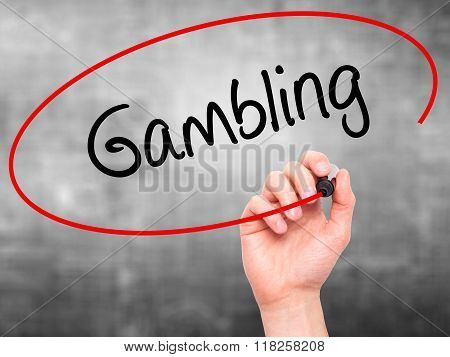Man Hand Writing Gambling  With Black Marker On Visual Screen