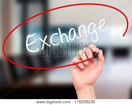 Man Hand Writing Exchange With Black Marker On Visual Screen