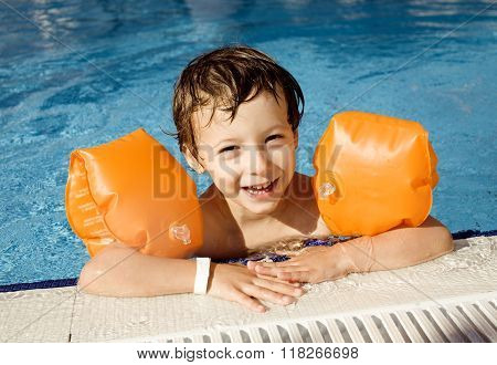 little cute boy in swimming pool close up