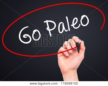 Man Hand Writing Go Paleo With Black Marker On Visual Screen