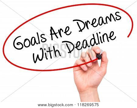 Man Hand Writing Goals Are Dreams With Deadline With Black Marker On Visual Screen