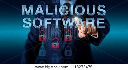 Black Hat Hacker Pressing Malicious Software