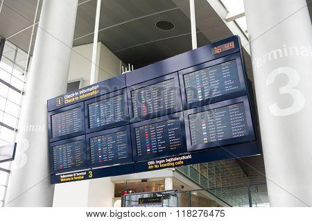 COPENHAGEN, DENMARK - June 21, 2015: Airport departure board screen at Kastrup airport, Copenhagen, DK