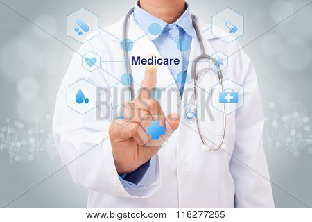 Doctor hand touching medicare sign on virtual screen. medical concept