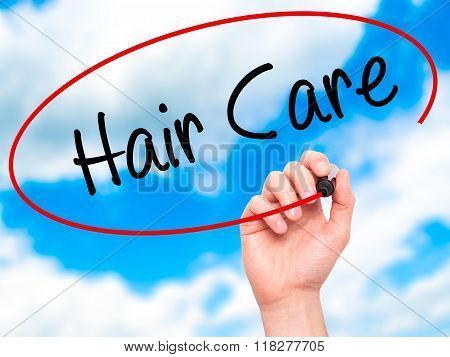 Man Hand Writing  Hair Care With Black Marker On Visual Screen