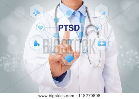 Doctor holding a tablet pc with PTSD sign on blue background