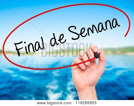 """Man Hand Writing """"final De Semana"""" (in Portuguese - Weekend) With Black Marker On Visual S"""