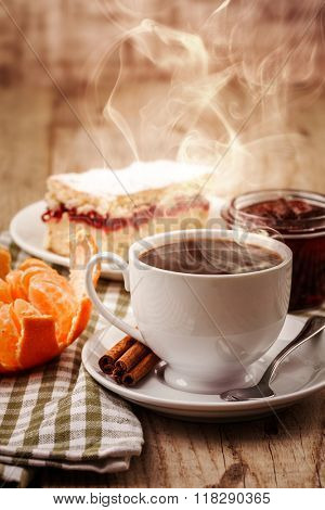 Cup coffee breakfast and cake rustic style on wooden board