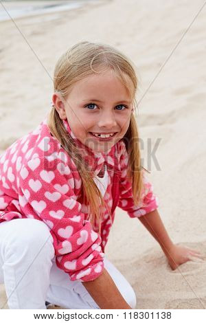 Portrait Of Young Girl Having Fun On Beach