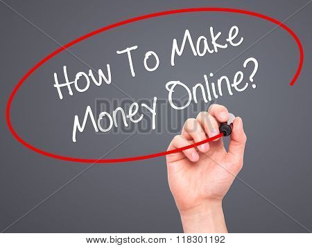 Man Hand Writing How To Make Money Online? With Black Marker On Visual Screen