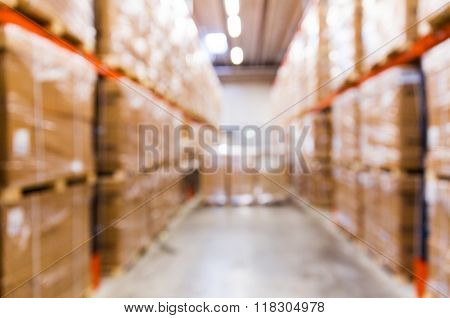 logistic, storage, shipment, industry and manufacturing concept - cargo boxes storing at warehouse shelves bokeh