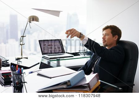 Daydreaming Successful Man Office Worker Throwing Paper Airplane