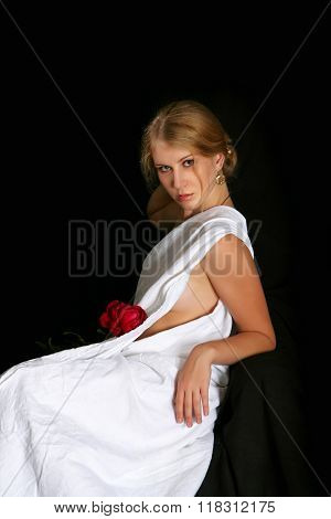 The girl on a black background with rose