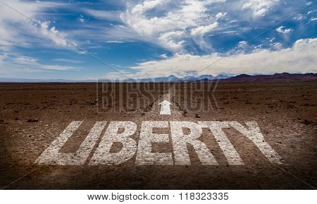 Liberty written on desert road