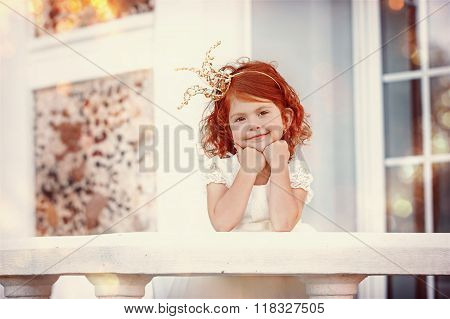Portrait Of Happy Little Beautiful Girl With Red Hair Wearing Cr