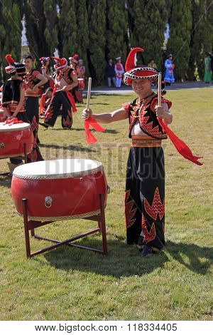 Kunming, China - January 7, 2016: Man Playing Drums Dressed With The Traditional Attire Of Yunnan, I