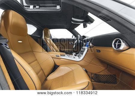 Car interior luxury sports salon with orange seats