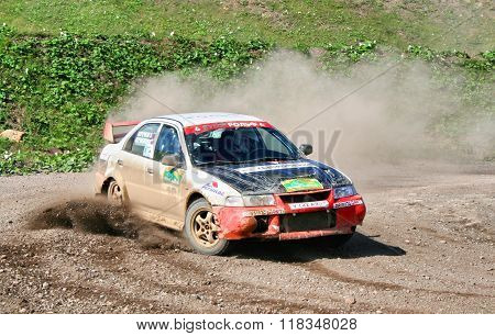 BAKAL, RUSSIA - AUGUST 8: Sergey Kornilkov's Mitsubishi Lancer Evolution (No. 16) competes at the annual Rally Southern Ural on August 8, 2008 in Bakal, Satka district, Chelyabinsk region, Russia.