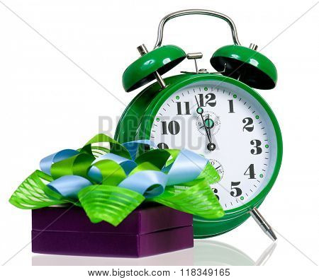 Gift box with green alarm clock, isolated on white background