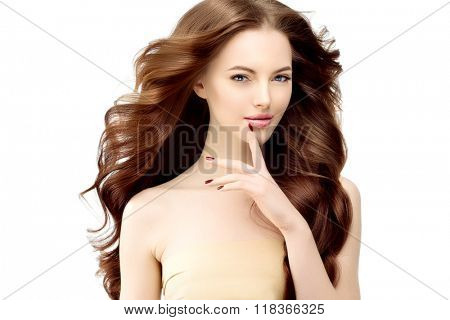 Woman Model with long wavy hair. Waves Curls Hairstyle. Hair Salon. Updo. Fashion model with shiny hair. Girl with healthy hair girl with luxurious haircut. Hair loss Girl with hair volume. Brunette