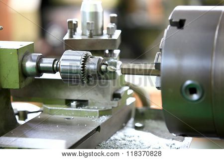 Close up shot of cutting tool on a lathe