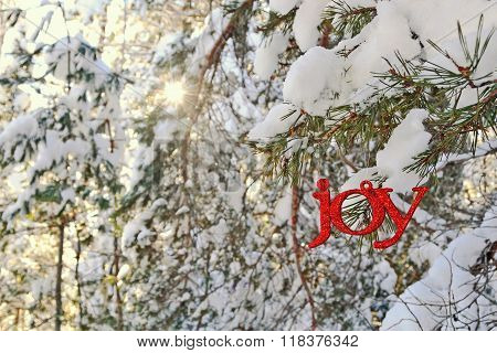 Joy Ornament In A Sunny Winter Forest