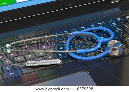 Stethoscope With  Thermometer On Laptop Keyboard