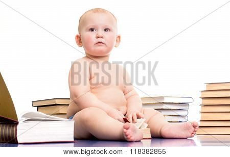 Little girl surrounded by books