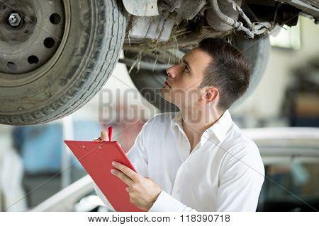 Inspector expert inspection damage on car