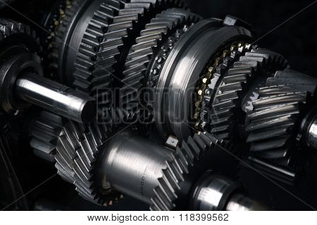 Automotive transmission gearbox isolated on black. Cogs and gears