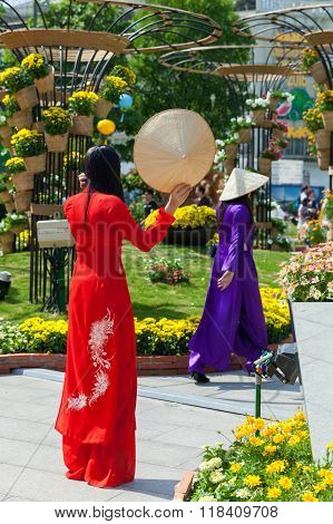 Two young Vietnamese women in traditional Ao Dai dress