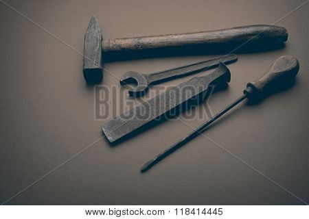 old tools on the brown paper background