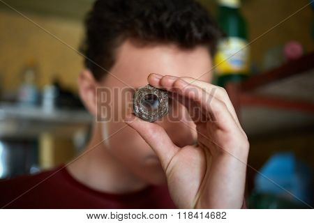 Teenager Boy Looking Through A Rusty Screw Nut